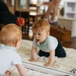 Montessori infant looking in mirror