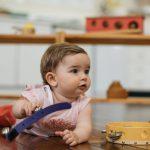 Montessori infant girl playing musical bells