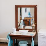 Child sized hand washing mirror table.