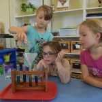 Montessori children conducting science experiment.