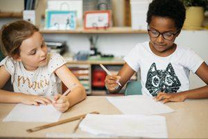 Montessori children problem solving through collaborating.