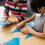 Children working with Montessori blue triangles.