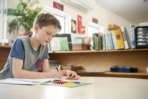 Child working on maths problem.