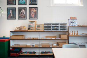 Shelf displaying Montessori mathematics materials.