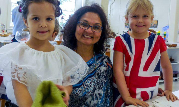 Montessori children and Director in multicultural dress.