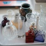 Glass vases in an orderly display.