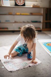 Child working with mathematics materials.
