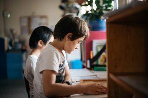 Montessori boys engaged in deep thinking.