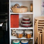 Display of drums on shelves.