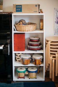 Display of drums on shelves.