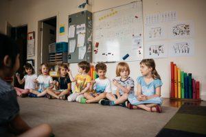 Children playing musical shakers.
