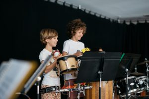 Montessori children playing percussion.