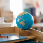 A globe of the world and a world puzzle.