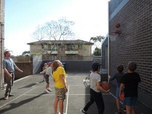 Children playing basketball at Montessori Balmain.